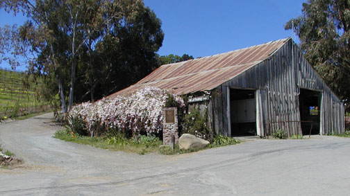 [ Photo of barn and plaque wide. ]